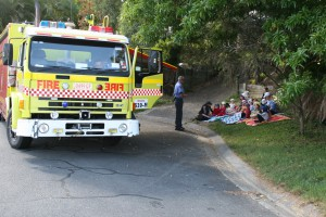 kids enthralled by firemen
